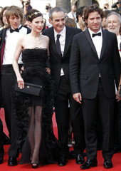 Director Assayas arrives on the red carpet with cast members of the film Carlos ahead of the screening of the film Poetry in competition at the 63rd Cannes Film Festival