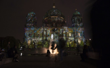 "People look at a light installation during the opening day of the ""Festival of Light"" show in Berlin"