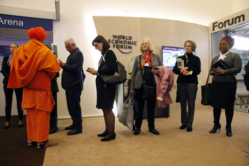 Attendees wait in line to attend a session during the WEF annual meeting in Davos