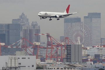JAL aircraft flies near Haneda airport in Tokyo