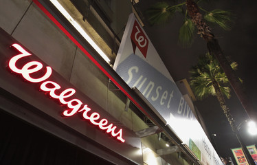 Walgreens signage and palm trees are pictured at the grand opening of drugstore chain Walgreens newest flagship store, and 8,000th store nationwide, on the famous corner of Sunset & Vine in Hollywood