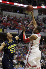 Ohio State's Sullinger shoots over Michigans Morgan during a mens Big Ten tournament game in Indianapolis.