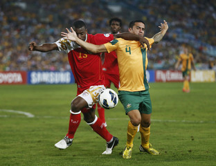 Oman's Sallam tussles with Australia's Cahill during their World Cup qualifying soccer match in Sydney