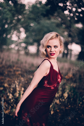Beautiful And Elegant Blonde Woman With Red Lips And Hair