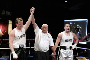 Boxer Gore Jr. is declared victorious over Cunningham after their fight during a night of Corporate Challenge Boxing in New York