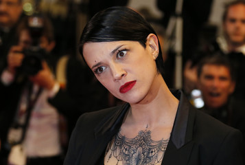 """Director Asia Argento poses on the red carpet as she arrives for the screening of the film """"Incompresa"""" in competition for the category """"Un Certain Regard"""" at the 67th Cannes Film Festival"""
