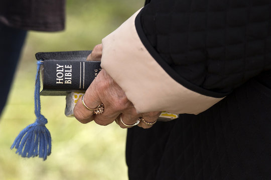 A woman holds a Bible at an open air Sunday church service four days after a deadly fertilizer plant explosion in the town of West, near Waco, Texas