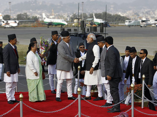 India's Prime Minister Narendra Modi shakes hand with Nepali Home Minister Bamdev Gautam upon his arrival to take part in the 18th South Asian Association for Regional Cooperation (SAARC) summit in Kathmandu