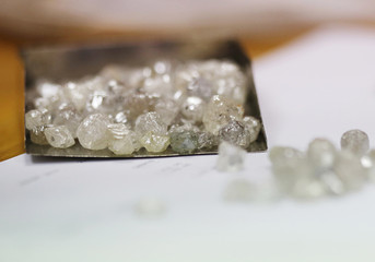 Uncut diamonds from the Leo Schachter Diamond Group's allocation are seen at De Beers offices in central London