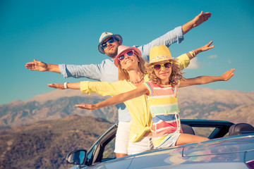 Happy family travel by car in the mountains