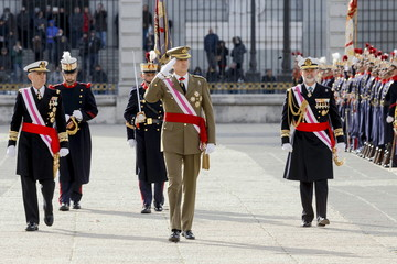 Spain's King Felipe VI reviews troops during the Epiphany Day celebrations at the Royal Palace in Madrid