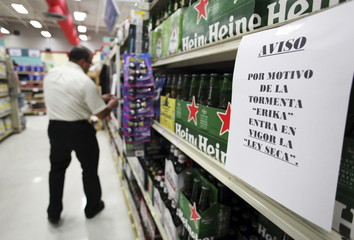 "A sign that reads ""No alcohol sale due to Tropical Storm Erika"" is seen at a supermarket in San Juan, Puerto Rico"