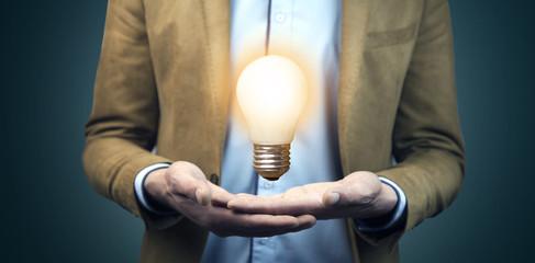 Hand of business man write light bulb