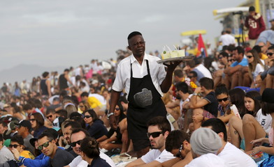 "A man sells ""caipirinha"" before the finals of the men's World Surf League (WSL) Rio Pro championship in Rio de Janeiro"