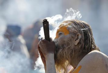 A Hindu holy man smokes marijuana at Pashupati Temple in Kathmandu