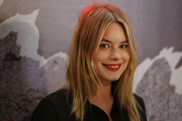 """Actress Camille Rowe poses at a premiere of the film """"Rock'n Roll"""" in Paris"""