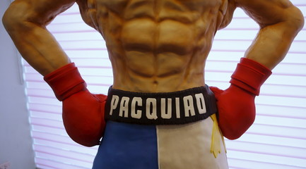 The name of local boxing icon Manny Pacquiao is pictured on a life-size 70-kg chocolate cake which is displayed to the media at a restaurant in Manila