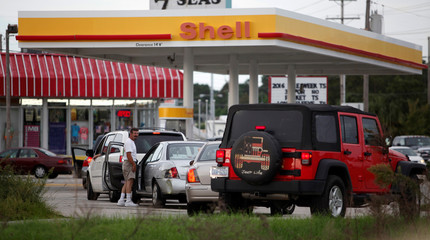 People line up to fill their cars with gas after South Carolina Governor Nikki Haley ordered a Wednesday afternoon evacuation of statewide coastal counties in anticipation of Hurricane Matthew in Myrtle Beach