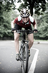 girl cyclist riding on a mountain bike outside in the town. lifestyle sport concept