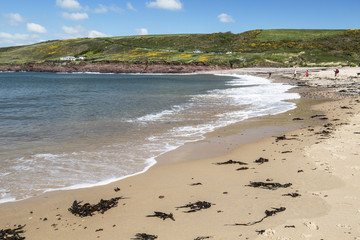 Bay at Manorbier in South Wales in the UK with the surrounding countryside in the distance.