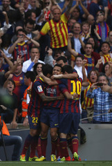 Barcelona's Sanchez is congratulated after scoring against Atletico Madrid during their soccer match in Barcelona