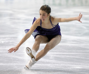 Alissa Czisny of the U.S. looses her balance while she skates during the women's free skate program at the International Skating Union (ISU) Grand Prix of Figure Skating Finals at the Pavillon de la Jeunesse in Quebec City