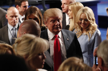 Republican U.S. presidential nominee Trump departs the stage with his family after the conclusion of the third and final debate with Democratic nominee Clinton in Las Vegas