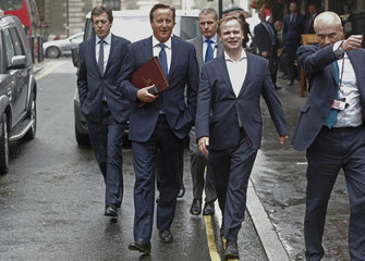 Britain's Prime Minister David Cameron walks to Parliament after leaving Number 10 Downing Street in London