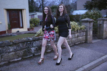 Yasmin Gray and Leonie Matthews pose for a photograph while getting ready to go to a friend's 16th birthday party in Nairn, Invernesshire
