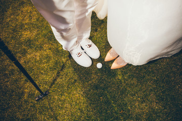 Happy Bride and Groom playing golf - Close up wedding