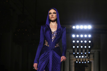 A model presents a creation by Italian designer Donatella Versace as part of her Haute Couture Spring/Summer 2014 fashion show for Atelier Versace in Paris