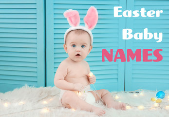 Cute little baby wearing bunny ears sitting on furry rug with garland