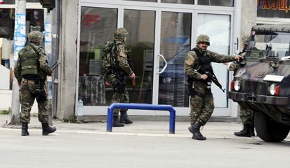 Macedonian policemen guard the premises in Kumanovo