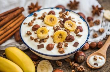 Serving of White Yogurt with  Muesli, Banana and Nuts
