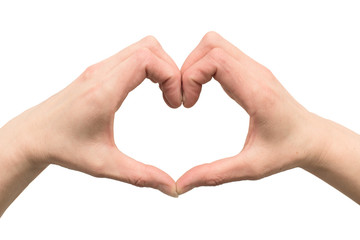 Hands of a woman stacked in the shape of a heart - isolated on a white background