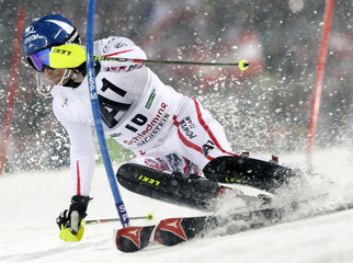 Raich of Austria clears a gate during the Alpine Skiing World Cup Slalom race in Schladming