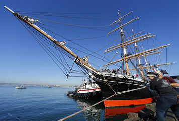 """Crew members help with the lines as the """"Star of India"""" sets out on a morning sail to celebrate its 150th birthday in San Diego"""