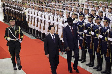South Sudan's President Mayardit inspects a guard of honour with his Chinese counterpart Hu in Beijing