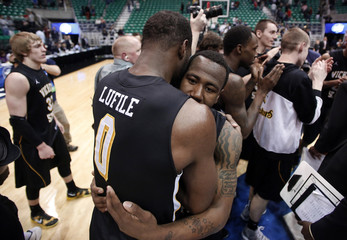 Wichita State forward Chadrack Lufile and guard Malcolm Armstead hug after the second half of their third round NCAA tournament basketball game against Gonzaga in Salt Lake City, Utah