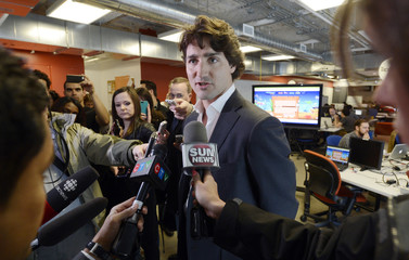 Liberal Party of Canada's leadership candidate Justin Trudeau speaks to the media at the Ryerson University Digital Media Zone in Toronto