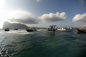 Gibraltarian police and the Spanish Civil Guard in their boats monitor a protest by Spanish fishermen in their fishing boats in Algeciras bay
