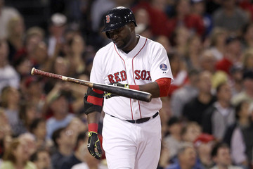 Boston Red Sox's Ortiz flips his bat after flying out against the Toronto Blue Jays during their MLB American League East baseball game in Boston
