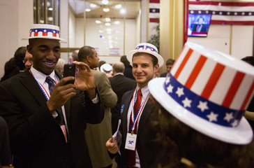 Party-goers with patriotic hats pose for photographs during an election party during the U.S. presidential election at the U.S Embassy in London