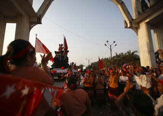 Supporters of Myanmar's Aung San Suu Kyi sing and dance in Yangon