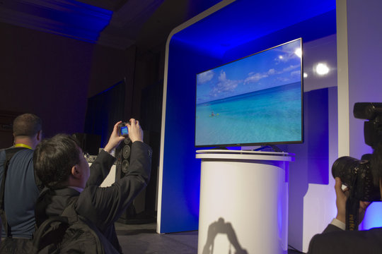 Journalists take photos of a 65-inch Panasonic CX850 4K LED Ultra HD Smart TV at a Panasonic news conference during the 2015 International Consumer Electronics Show (CES) in Las Vegas
