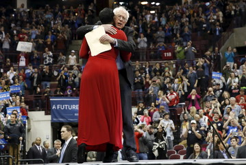U.S. Democratic presidential candidate Bernie Sanders embraces former state senator for Ohio's 25th district Nina Turner during a rally at the Schottenstein Center at The Ohio State University in Columbus, Ohio
