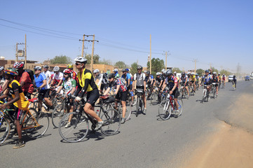 Cyclists ride into Khartoum during the Tour d'Afrique cycling expedition