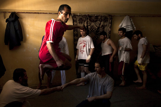 Afghan inmates attend a martial art class at Kabul's Pul-i-Charkhi prison during a media visit organized by Afghanistan's Sports Persuasive Foundation