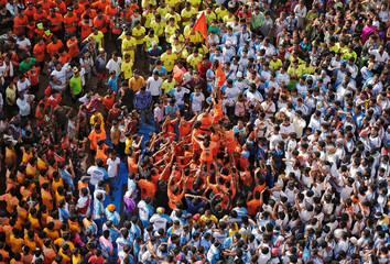 Devotees form a human pyramid to celebrate the festival of Janmashtami in Mumbai