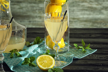 Delicious lemon juice in glasses on kitchen table